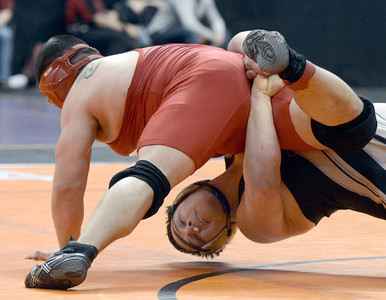 Canon City High School's Garrett Benell, right, wrestles Pueblo Centennial's Damian Garcia during the Class 4A 220-pound match during the Colorado State Wrestling Championship quarterfinals on Friday, Feb. 22, at the Pepsi Center in Denver. For more photos of the tournament go to www.dailycamera.com Jeremy Papasso/ Camera