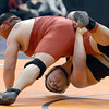 "Canon City High School's Garrett Benell, right, wrestles Pueblo Centennial's Damian Garcia during the Class 4A 220-pound match during the Colorado State Wrestling Championship quarterfinals on Friday, Feb. 22, at the Pepsi Center in Denver. For more photos of the tournament go to  <a href=""http://www.dailycamera.com"">http://www.dailycamera.com</a><br /> Jeremy Papasso/ Camera"