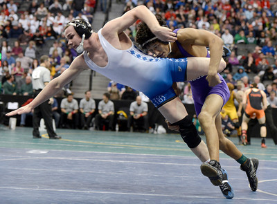 Broomfield High School's Phil Downing gets taken down by Mesa Ridge High School's Dominique Hughes during the Class 4A 145-pound match during the Colorado State Wrestling Championship semifinals on Friday, Feb. 22, at the Pepsi Center in Denver. Downing won the match. For more photos of the tournament go to www.dailycamera.com Jeremy Papasso/ Camera