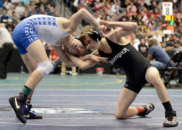 "Broomfield High School's Darek Huff, left, ties up with Discovery Canyon's Sam Turner during the Class 4A 106-pound match during the Colorado State Wrestling Championship semifinals on Friday, Feb. 22, at the Pepsi Center in Denver. Huff lost the match. For more photos of the tournament go to  <a href=""http://www.dailycamera.com"">http://www.dailycamera.com</a><br /> Jeremy Papasso/ Camera"