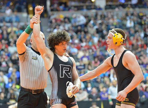 Roosevelt's Jace Lopez, left, defeated Thompson Valley's Parker Simington    in the 138-pound semi-final match in class 4A during the state wrestling championships at the Pepsi Center in Denver on Friday.<br /> February 22, 2013<br /> staff photo/ David R. Jennings