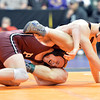 Ft. Morgan's Ian Wingstrom, right, wrestling Dalton Hanningan, Palisade  in the 126-pound semi-final match in class 4A during the state wrestling championships at the Pepsi Center in Denver on Friday.<br /> February 22, 2013<br /> staff photo/ David R. Jennings