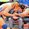 Broomfield's Zach Stodden, left,  wrestling Air Academy's Caleb Cuneio in the 170-pound semi-final match in class 4A during the state wrestling championships at the Pepsi Center in Denver on Friday.<br /> February 22, 2013<br /> staff photo/ David R. Jennings