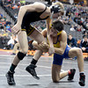 "Thompson Valley High School's Collin Williams, left, escapes an attempted takedown by Frederick's Jesse Ortiz during the Class 4A 113-pound match during the Colorado State Wrestling Championship quarterfinals on Friday, Feb. 22, at the Pepsi Center in Denver. Williams won the match. For more photos of the tournament go to  <a href=""http://www.dailycamera.com"">http://www.dailycamera.com</a><br /> Jeremy Papasso/ Camera"
