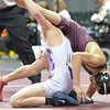 Merino's Marcelino Baptista, top,  wrestling Brandon Grasmick, Fowler,  in the 113-pound semi-final match in class 2A during the state wrestling championships at the Pepsi Center in Denver on Friday.<br /> February 22, 2013<br /> staff photo/ David R. Jennings