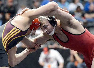 Durango High School's Nick Tarpley, right, ties up with Windsor High School's Kennen Lanteri during the Class 4A 152-pound match during the Colorado State Wrestling Championship quarterfinals on Friday, Feb. 22, at the Pepsi Center in Denver. For more photos of the tournament go to www.dailycamera.com Jeremy Papasso/ Camera