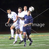 Campolindo High's Kian Maghsoodnia heads the ball in the second half of a Diablo Valley Athletic League boys soccer game against Miramonte High in Orinda, California, on Friday, January 18, 2013. Campolindo won 2-0. Photo by David Yee ©2013