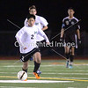 Miramonte High's Avery Wong drives the ball against Dougherty Valley High during the second half of a Diablo Foothill Athletic League boys soccer game in Orinda, California, on Friday, February 1, 2013. Miramonte won 2-1. Photo by David Yee ©2013