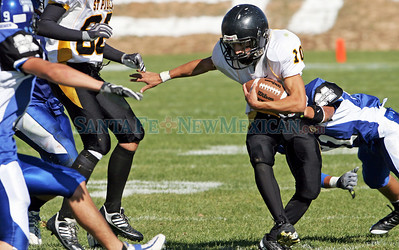 (10) of Albuquerque St. Pius X returns a punt during the fourth quarter of a football game against St. Michael's in Santa Fe, N.M. on Oct. 3, 2009. ©Natalie Guillen/The New Mexican