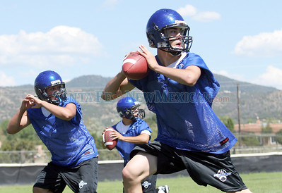 (front to back) Josh Roybal, J.J. Trujillo, and Corey Serna run drills during a St. Michael's High School football practice in Santa Fe, N.M. on Aug. 10, 2009. ©Natalie Guillen/The New Mexican