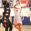 Derrick Riviello shoots for two points Friday, Jan. 13 against Geneva.