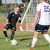 Simon Wigmore grabs the ball for Watkins Glen in the home game last week.