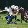 Sam Richards (33), Cameron Denmark (68) and Joshua Cramer (32) work together to tackle and strip the ball, causing a Mynderse fumble, Friday, Oct. 6.