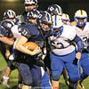 Casen Weeden pulls away from a tackle to gain yardage for the Seneca Indians Saturday night.