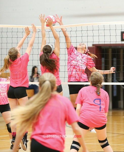 Mackenzie Strait spikes the ball at the net as two Bloomfield players try to block Thursday, Oct. 12.