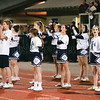 The cheerleading squad encouraged the football team during the homecoming game against Lansing.