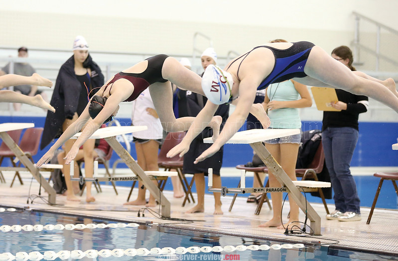 Megan Adams dives into the pool to start the 500 freestyle event last week.