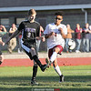 Preston Harris battles for control of the ball near midfield in Odessa's first sectional game.