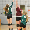 Megan Sutherland goes up at the net to deflect the ball away from the HAC defender.