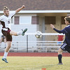 Cam Howell boots the ball upfield during the home soccer game.