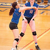 Akiya Brewer, left, volleys as Emily Wunder looks on during the Class B championship, Saturday, Nov. 4. GREG FRANCIS PHOTO