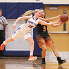 Joddie Decker reaches to try to steal the ball, Friday, Dec. 15, against Waterloo.