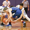 Cameron Roote and Parker Watson work to defend against the Romulus offense, Wednesday, Nov. 30.