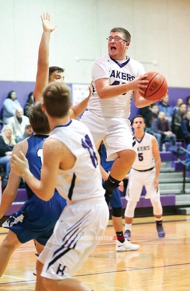 Billy Whitney goes up near the basket to shoot last week.