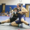 Charlie Wright competes in a match early in the sectional tournament, Friday.