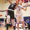Elissa Callaway jumps for a rebound in the Friday, Feb. 10, game against Geneva.
