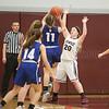 Megan Sutherland goes up to block a shot, Friday, Feb. 10.