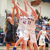 Lizzy Lafferty and Emily Wunder grab for a rebound in the Wednesday night game against Wayne.