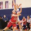 Jenna Curbeau reaches to control the ball Wednesday, Feb. 22.