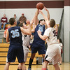 Blake Cratsley and John Clancey jump for a rebound in the Friday game against Lima Christian.
