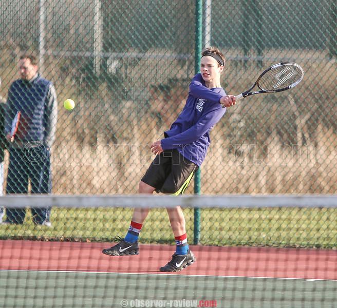 Peter Sandritter volleys in the match against Newark Valley last week.