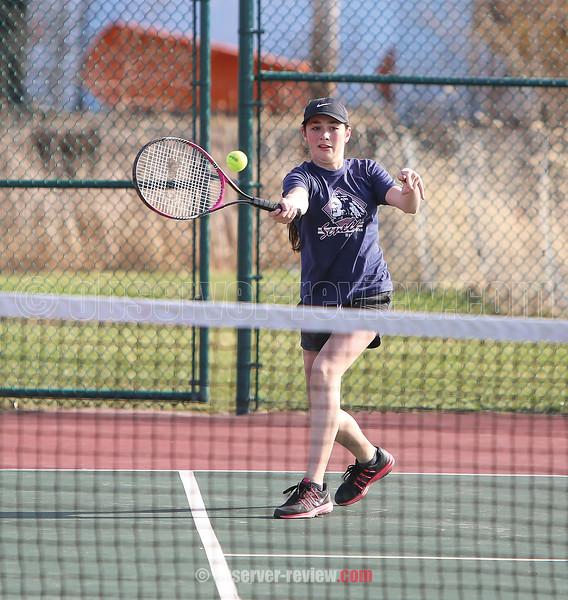 Singles player Jill Cantieni returns a serve, Wednesday, April 5.