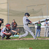 Johnny Neidermaier connects with the ball during the game Wednesday, April 12 against Trumansburg.