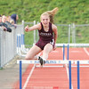 Kennedey Heichel jumps a hurdle in the 400 meter hurdle race, Friday.