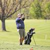 Ryan Clark watches his approach shot at the Watkins Glen Golf Course last week.