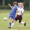 Colby Secord tries to gain control of the ball last week.