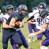 Casen Weeden is pulled down after running the ball in the game against Spencer-Van Etten/Candor.