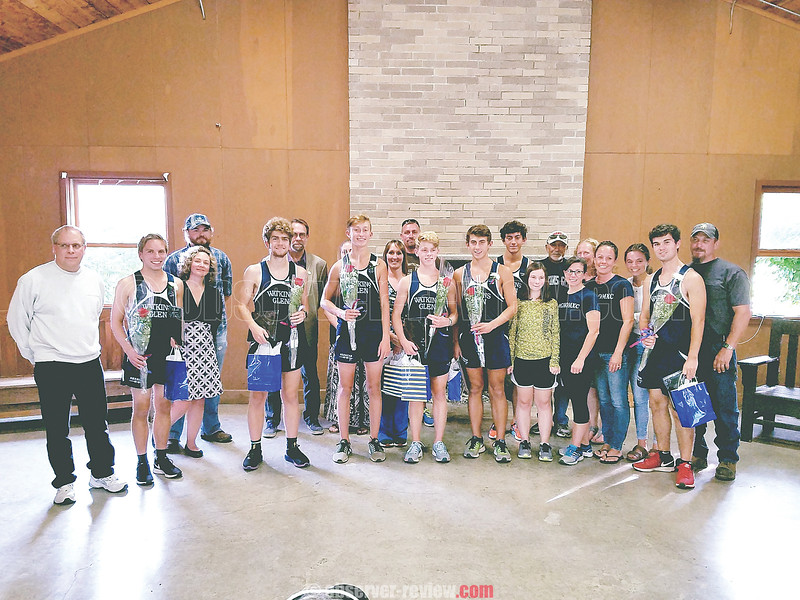Watkins Glen seniors Conlin Wysocki, Julian Thornton, Dan Paradiso, Sean Holland, Aaron Planty, and Tanner Ryan have a photo taken with their families at the Watkins Glen state park, Tuesday, Sept. 12. PROVIDED • Rod Weeden
