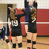 Emmie Bond returns the ball in the game last week.