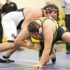Dylan Houseknecht works to control his opponent in the championship match, Saturday, Jan. 13.