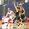 Peyton Comfort moves the ball into the paint in the championship game Friday, Dec. 29.