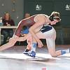 Paul Knapp sprawls to defend against a shot, Thursday, Dec. 28, wrestling his Mynderse opponent.