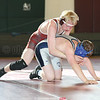 Phoenix Ault reaches for a crossface in the match against Mynderse.