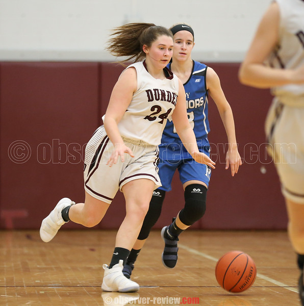 Makenzie Cratsley brings the ball up court in the game Thursday, Jan. 25.