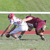 Dundee's Austin Gibson tackles the Red Jacket quarterback effectively sealing the game for Dundee with a 28-20 win.