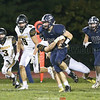 Casen Weeden breaks away from the defense to pickup yardage for the Seneca Indians, Friday, Sept. 28.